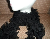 Beautiful hand knitted frilly Black Scarf in Flamenco yarn, washable.