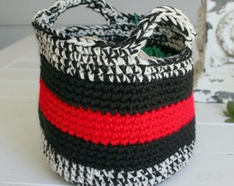 This adorable hand chrocheted basket is made with black, white and red. Items in basket not included