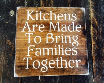 Kitchens are made to bring families together.12x12 stained wood sign. Stenciled and hand painted lettering. Hung with sawtooth hanger Sealed
