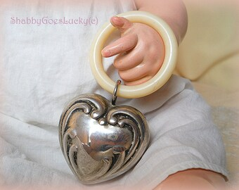 German vintage baby rattle, silver plated, unmarked, heart shaped with celluloid teething ring for large baby doll, 1950s, Art Deco design