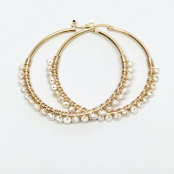 So beautiful earrings, they are big and shiny, a lot of pear and round shaped zirconias sparkle under the light, the post with latches makes earrings stay on my ears, comfortable to wear, great! (24).