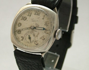 A gents 1930s silver Everite wrist watch