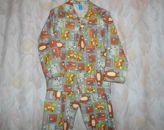 Size 8 Boys Pajamas with animals on a grely back ground
