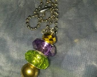 Beautiful and shiny mardi gras pendant