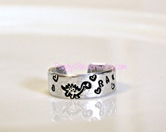 Dinosaur ring. RAWR, means I love you in Dinosaur.  Hand stamped custom made.
