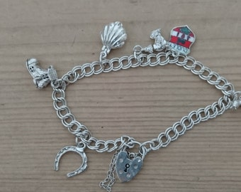 Vintage sterling silver charm bracelet with six charms