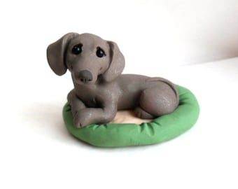 Blue Dachshund in dog bed polymer clay dog sculpture by Raquel at the WRC