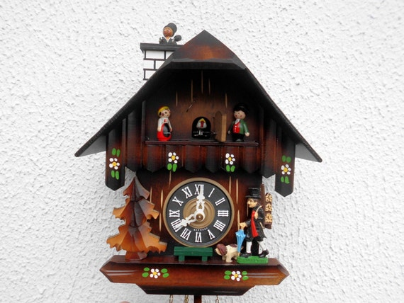 Animated Black Forest Cuckoo Clock With Popping Chimney Sweep