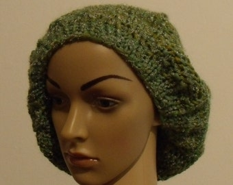 Knitted beret in shades of green with silver