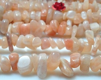 35 inches of Natural Sunstone  smooth  chip beads in  5-8mm