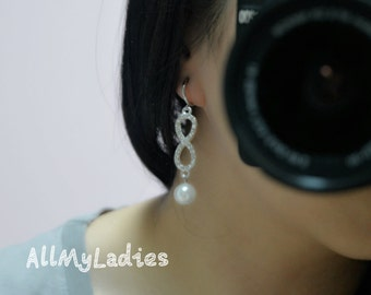 Infinite CLIPS dangling earrings with white pearls