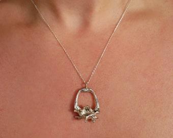 Mouse pelvis necklace pendant