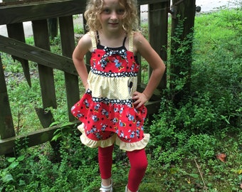 Size 5. Tiered Minnie top with ruffled shorts