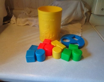 Childs learning toy,Shape blocks in cannister by Fisher Price 1977 vintage,clean & complete