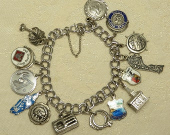 Vintage retro sterling silver traditional Disney Hawaii spinner stanhope and more travel souvenir charm bracelet many charms