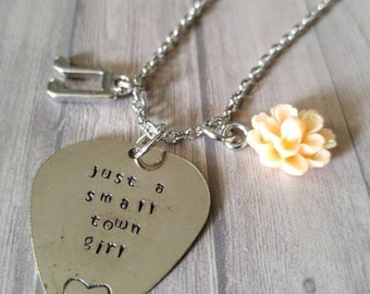 Just a small town girl journey stamped necklace with a music note charm and a flower charm