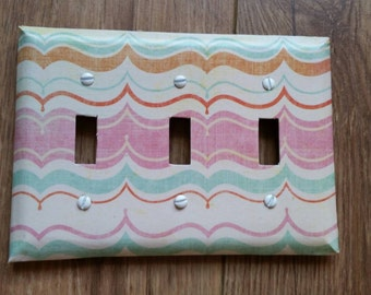 Triple switch plate cover waves