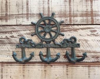 Cast iron captain wheel and anchor hooks