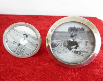 Two TINY sterling silver photo frames, round