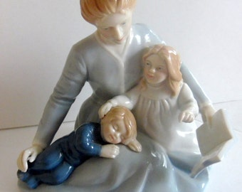 1984 Mother's Day, porcelain figurine, entitled: A Mother's Touch.  It is a young mother, reading a book to her boy and girl