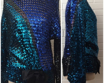 Sequined Asymmetrical Peplum Top Size M/L