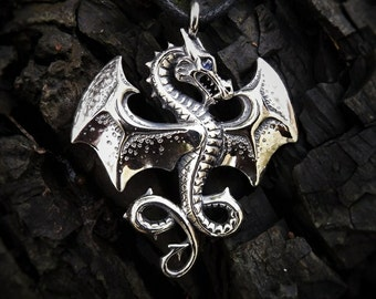 Celtic Dragon necklace , silver and sapphire pendant.