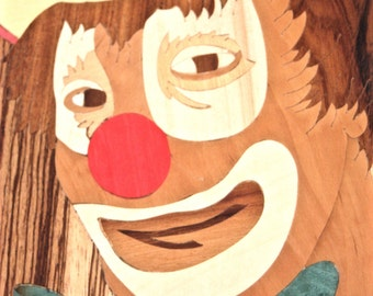A marquetry portrait of a clown, made in Sorrento.