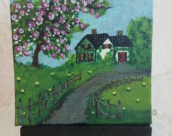 Esther's Place at the end of the lane. Free easel and shipping with purchase.