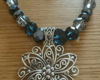 Navy blue and silver beaded necklace with flower pendant