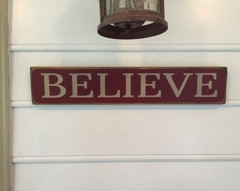 "Believe Sign. Rustic Country Christmas Sign. Country Primitive Christmas Decor. The approximate size of the sign is 23"" x 4 1/2"" x 3/4""."