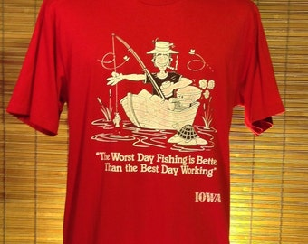 "Vintage 1985 XL (46) Iowa souvenir t-shirt: ""The Worst Day Fishing is Better Than the Best Day Working"". Red Jerzees brand, 50% cotton and"