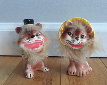 Pair of Porcelian Antique Lions