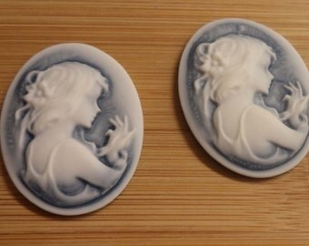 40mm x 30mm oval resin cameo of girl holding bird white on blue darker background 2 pc lot l