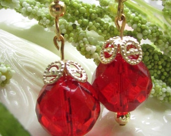 Red glass multi-faceted dangle earrings