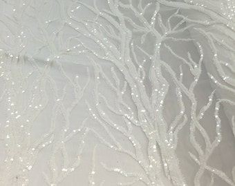 Shinny off white fashion tree design embroider with sequins on a 2 way stretch -sold by yard