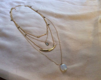 Gold tone 4 layer necklace with charms