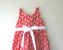 Lobster dress, a funky white lobster print on red fabric dress with a white sash and bow with contrasting red stitching.