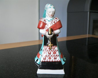 Herend Hungarian handpainted porcelain religious lady figurine - figure carrying a bible and a cross - In traditional Hungarian costume