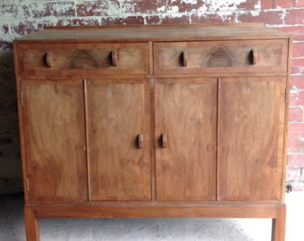 Fabulous Antique 1920's/30's Walnut Cupboard With Folding Doors and Half Circle Handles.
