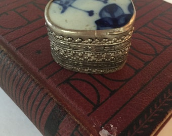 Vintage Trinket Box with Blue and White Porcelain Lid and Embossed Metal Casing