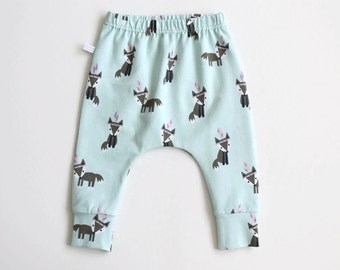 Mint green slim fit harem pants with foxes. Baby or infant pants. Jersey knit fabric. Kids leggings with cuffs. Cute small foxes pattern