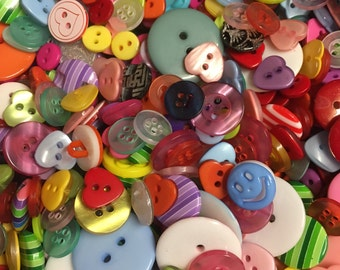 50g Quality Resin Buttons. Assorted mix of designs and colours. Ideal for sewing, scrapbooking and other crafts.