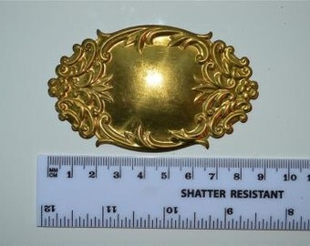 Original antique pressed brass furniture mount G12