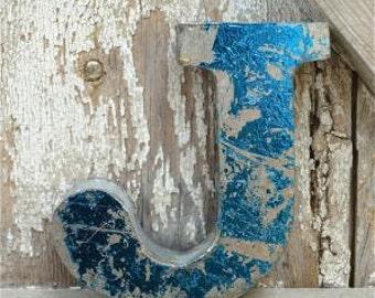 A fantastic vintage style metal 3D blue letter J