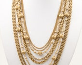 Chic vintage signed Lisner eight strand gold tone metal chain statement necklace, c. 1950s 1960s fluted bead and chain multi-strand necklace
