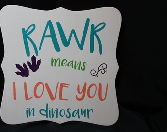 RAWR means I love you in dinasaur wooden placque