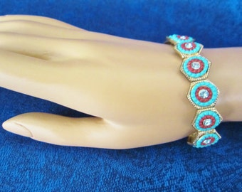 Vintage Stretch Panel Bracelet- elegant in style comfortable to wear .14 turquoise & coral  hexagonal links, a concentric faux center piece!