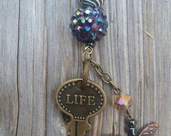 Antique gold metal Life key long necklace.