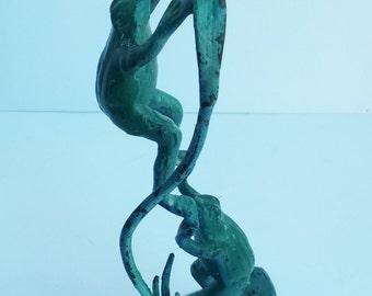 Distressed Green/Blue Metal Frog Boosting Another Frog Single Candlestick Holder
