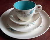 Vintage dinnerware Salem Biscayne 62Z.  Light cream-colored pieces with turquoise and sand leaves simple daisy outline with pink center.